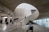 a person walks up some spiral stairs in Tate Modern's Tanks