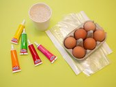 materials for making speckled eggs, rice, plastic bags, food dye and eggs