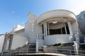 The front of Tate St Ives' gallery building on a sunny day