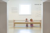 Children sat on the floor drawing in Tate St Ives.