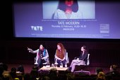 Three women onstage as part of a conference panel
