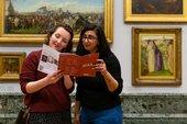 two people look at a map in Tate gallery