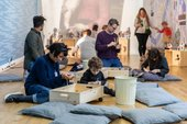 Kids and their parents playing in the Learning Gallery at Tate Britain