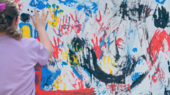 a girl painting with her hands