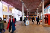 Tate Liverpool foyer with lots of visitors inside.