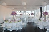 Photograph of East room set up with round tables, white table cloths and flowers