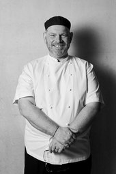 Black and white photograph of head chef Spencer Ralph