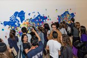 Photograph of young people interacting with a map at the Tate Modern opening