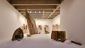 gallery with objects on a floor covered in salt