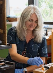 Paintings conservator Susan Breen at work in the conservation studio at Tate Britain, 2020