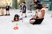 a parent and child draw together on the floor