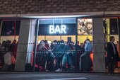 Crowded Tate Modern Bar at night