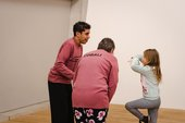 Photograph of two adults and a child taking part in 'Testing testing testing' at Tate Modern