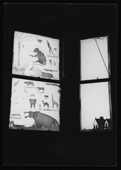 Photograph of a blackout window with carvings