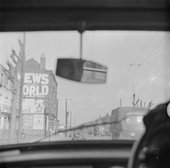 The view from a car looking through the windscreen toward News of the World Building in London