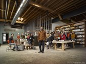 portrait of Theaster Gates and other people in his studio