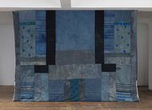 An artwork of patchwork textiles in shades of blue