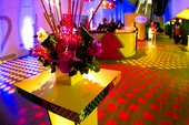 bright lights and flowers on a table
