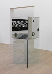 mirrored cube sculpture with holes in