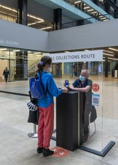 A visitor having their ticket scanned by a member of staff.