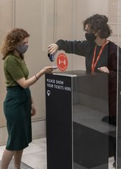 A visitor has their ticket scanned at Tate Britain.