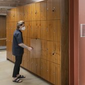 Person opening a locker at Tate Liverpool.