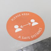 Please keep your distance sign printed on the floor.