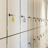 white lockers with keys in the doors.