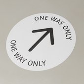 one way only arrow printed on the floor.