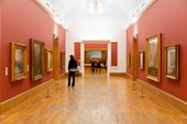 Interior view of the Clore Gallery, Tate Britain with paintings by J.M.W. Turner displayed ion the wall