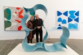 two people stand and look at a blue metal shaped sculpture David Annesley Godroon 1966