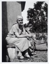 Photograph of Vanessa Bell sitting outside her home, Charleston farmhouse in Sussex, 1928 © Tate