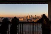 Photograph of visitors on the viewing platform at Tate Modern looking at the view across the River Thames