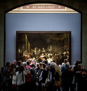 Visitors crowding around Rembrandt's The Night Watch at the Rijksmuseum in Amsterdam - Koen van Weel/AFP/Getty Images