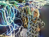 The artist Marta Minujín poses with a neon artwork in in Menesunda Reloaded at the New Museum in New York 2019