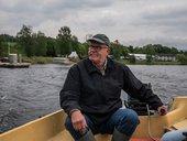 Lars Hvinden in his boat on Randsfjorden, Røykenvik