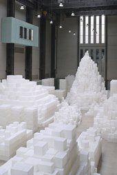 Stacked white cubes in turbine hall