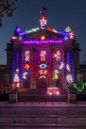 The facade of Tate Britain is lit up with Chila Kumari Singh Burman's Winter Commission