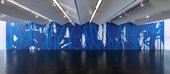 Large scale wall painting with blue paint