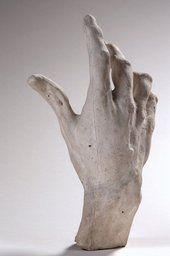 white plaster cast of a hand