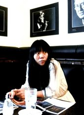 Photograph of Xiaolu Guo in a cafe
