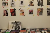Zines on a table and wall