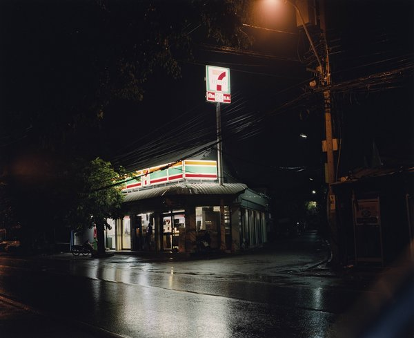 Photograph taken at night of a Seven Eleven shop