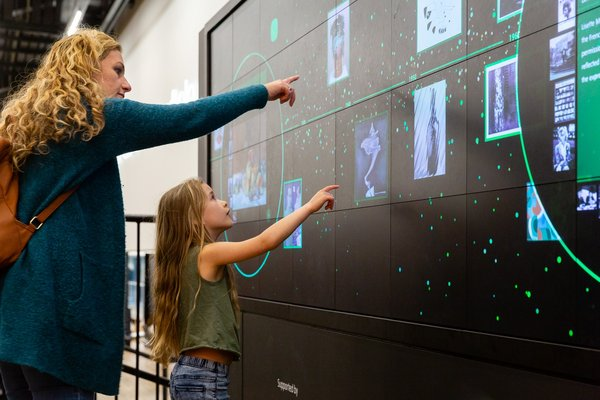Family interacting with the Bloomberg Digital Timeline at Tate Modern