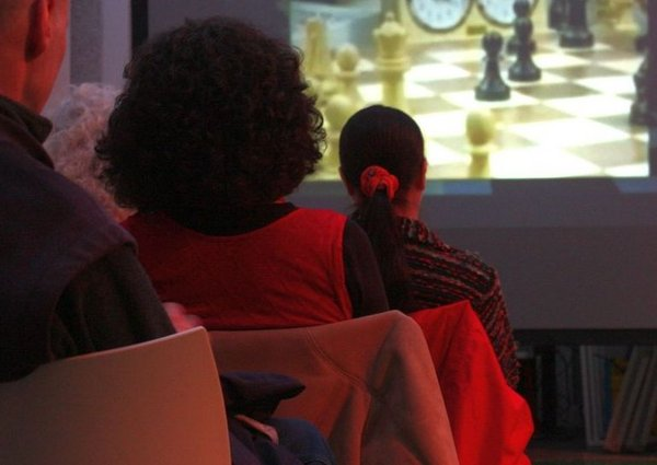 Visitors sitting and watching a film screening