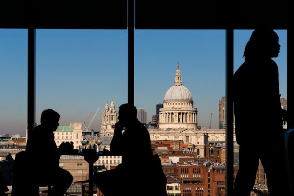 People enjoying the view and a drink in the Kitchen Bar at Tate Modern