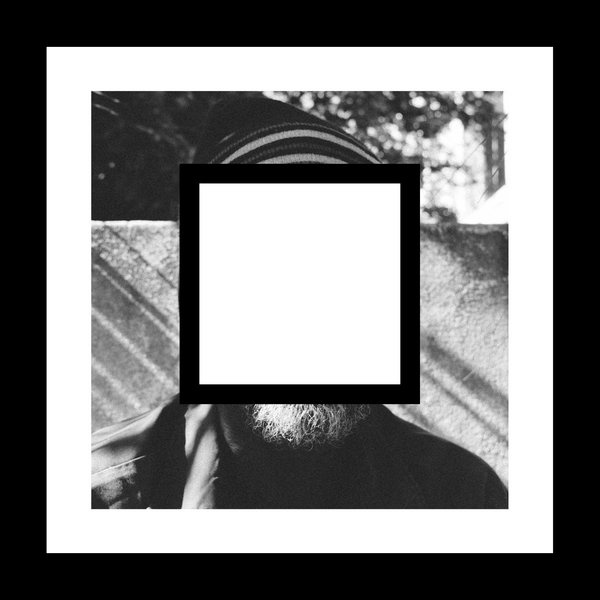 Man with a white square obscuring his face