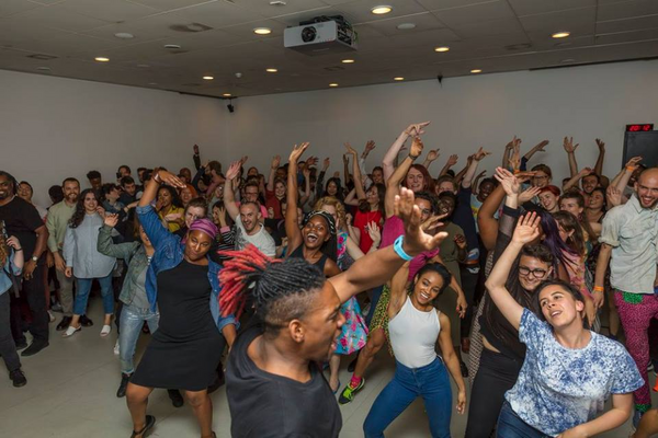 People participating in a vogueing workshop
