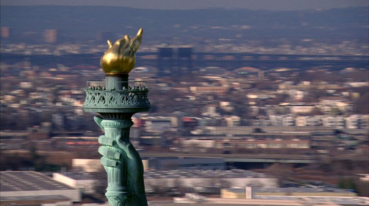 Still from McQueen film showing the torch of the statue of Liberty
