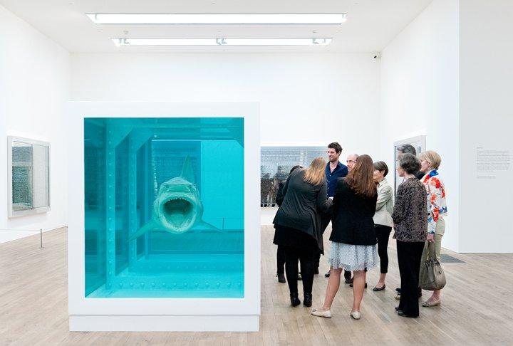 Patrons enjoy a curator-led tour of Damien Hirst at Tate Modern